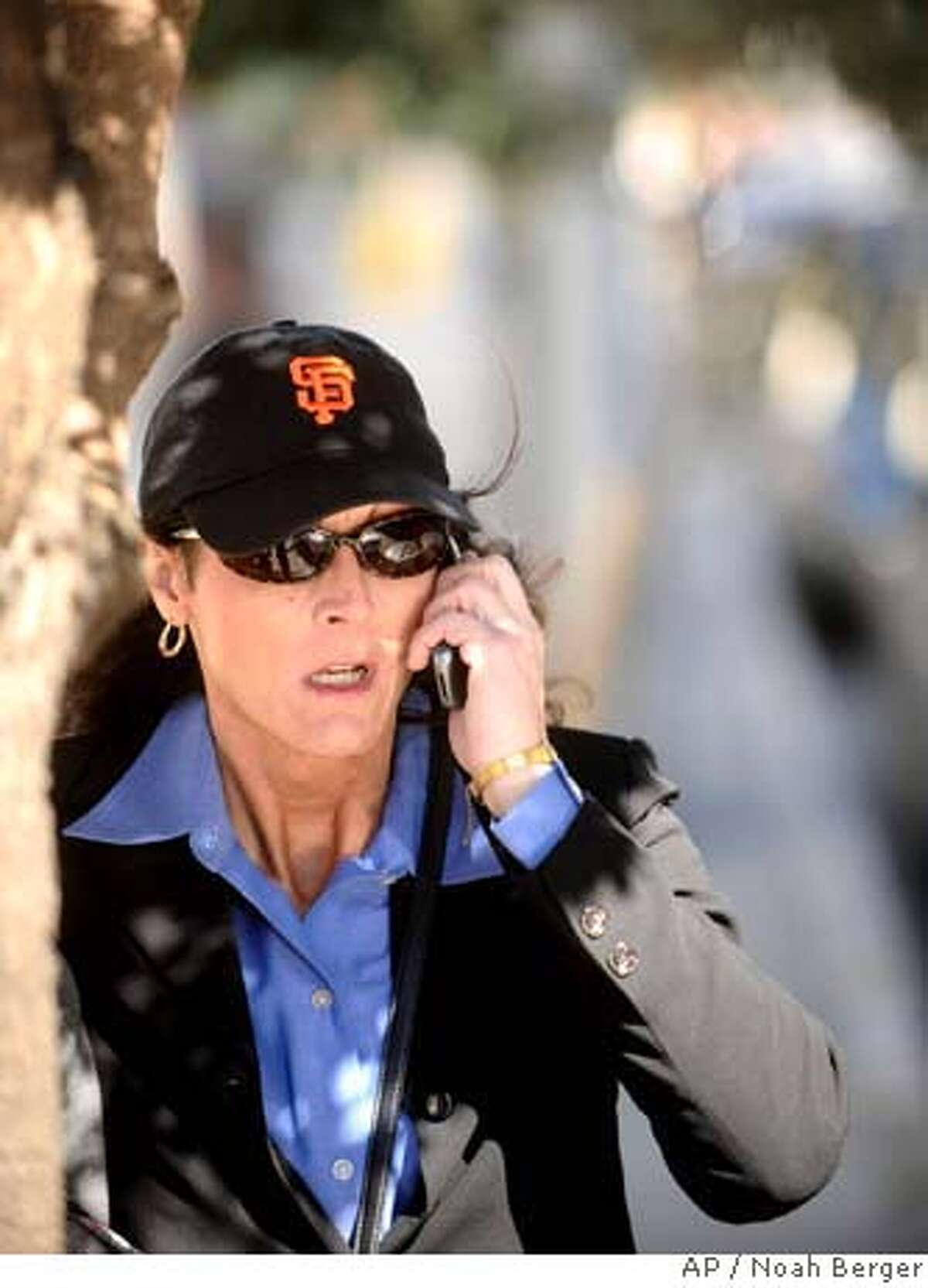 ###Live Caption:Former Olympic cyclist Tammy Thomas talks on her cell phone as she leaves the federal courthouse in San Francisco on Tuesday, March 25, 2008. Thomas is charged with perjury and obstruction of justice for allegedly lying to a federal grand jury investigating a steroid ring that spanned many sports. (AP Photo/Noah Berger)###Caption History:Former Olympic cyclist Tammy Thomas talks on her cell phone as she leaves the federal courthouse in San Francisco on Tuesday, March 25, 2008. Thomas is charged with perjury and obstruction of justice for allegedly lying to a federal grand jury investigating a steroid ring that spanned many sports. (AP Photo/Noah Berger) Ran on: 03-26-2008 Banned cyclist Tammy Thomas, shown outside court in San Francisco, is charged with perjury and obstruction of justice. Ran on: 03-26-2008 Banned cyclist Tammy Thomas, shown outside court in San Francisco, is charged with perjury and obstruction of justice.###Notes:Tammy Thomas###Special Instructions: