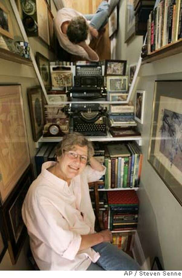 ###Live Caption:Cassandra Ormiston is surrounded by books and a typewriter in her Providence, R.I., home Wednesday, April 9, 2008. Ormiston married Margaret Chambers in Massachusetts in 2004, but the two are unable to get divorced in their home state of Rhode Island, the state's highest court has ruled. (AP Photo/Steven Senne)###Caption History:Cassandra Ormiston is surrounded by books and a typewriter in her Providence, R.I., home Wednesday, April 9, 2008. Ormiston married Margaret Chambers in Massachusetts in 2004, but the two are unable to get divorced in their home state of Rhode Island, the state's highest court has ruled. (AP Photo/Steven Senne)###Notes:Cassandra Ormiston###Special Instructions: Photo: Steven Senne
