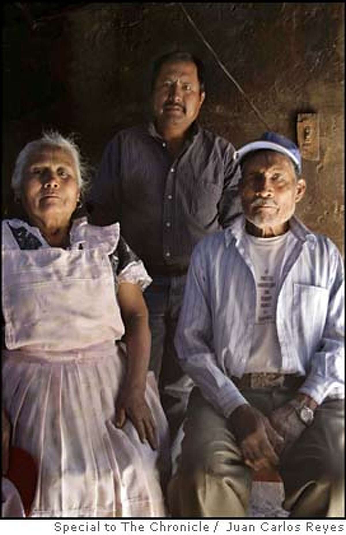 ###Live Caption:Jesus Leon, co-founder of a local environmental group, stands between his father, Agustin Leon, and mother, Guillermina Santos. Leon is at his parent's home in the town of San Isidro Tilantongo in the southern Mexican state of Oaxaca.###Caption History:Jesus Leon, co-founder of a local environmental group, stands between his father, Agustin Leon, and mother, Guillermina Santos. Leon is at his parent's home in the town of San Isidro Tilantongo in the southern Mexican state of Oaxaca.###Notes:###Special Instructions: