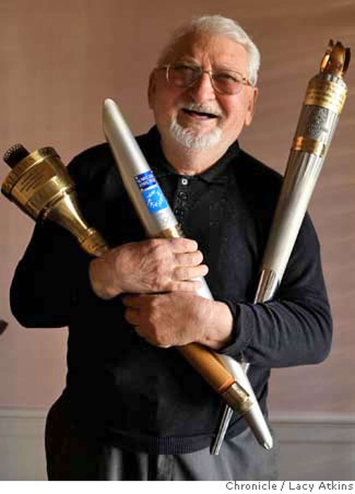 ###Live Caption:Vladimir Prikupets, 75-year-old, holds Olympic torches from Los Angeles, left, Athens and Salt Lake City, at his home, Monday, March 17, 2008, in San Francisco, Calif. Prikupets, has been to 10 Olympic games and has participated in three previous Olympic torch relays. Photo by Lacy Atkins / San Francisco Chronicle###Caption History:Vladimir Prikupets, 75-year-old, holds olympic torches from Los Angeles, left, Athens and Salt Lake City, at his home, Monday March 17, 2008, in San Francisco, Calif. Prikupets, has been to 10 olympics and has participated in 3 previous olympic torch relays. Photo by Lacy Atkins / San Francisco Chronicle###Notes:Vladimir Prikupets###Special Instructions:MANDATORY CREDIT FOR PHOTOG AND SAN FRANCISCO CHRONICLE/NO SALES MAGS OUT
