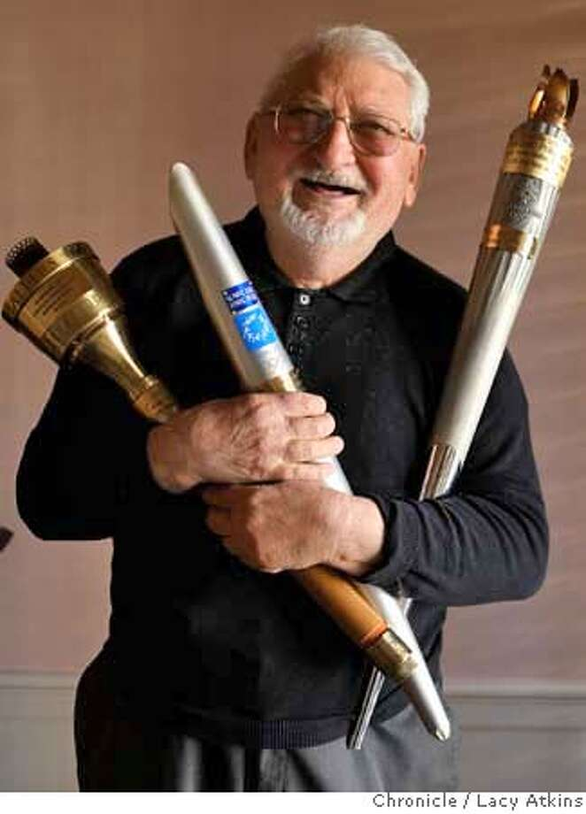 ###Live Caption:Vladimir Prikupets, 75-year-old, holds Olympic torches from Los Angeles, left, Athens and Salt Lake City, at his home, Monday, March 17, 2008, in San Francisco, Calif. Prikupets, has been to 10 Olympic games and has participated in three previous Olympic torch relays. Photo by Lacy Atkins / San Francisco Chronicle###Caption History:Vladimir Prikupets, 75-year-old, holds olympic torches from Los Angeles, left, Athens and Salt Lake City, at his home, Monday March 17, 2008, in San Francisco, Calif. Prikupets, has been to 10 olympics and has participated in 3 previous olympic torch relays. Photo by Lacy Atkins / San Francisco Chronicle###Notes:Vladimir Prikupets###Special Instructions:MANDATORY CREDIT FOR PHOTOG AND SAN FRANCISCO CHRONICLE/NO SALES MAGS OUT Photo: Lacy Atkins