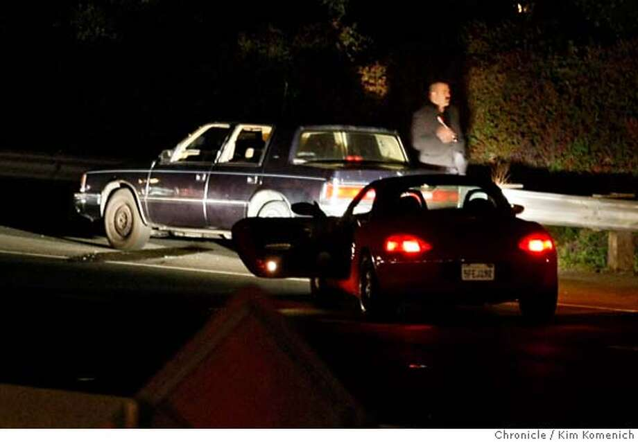 An Investigator checks a car that was involved in a homicide which came to a stop on Interstate 80 Westbound between the Appian Way and Richmond Parkway exits in Pinole, Calif. on Thursday night, April 3, 2008, Photo by Kim Komenich / San Francisco Chronicle Photo: Kim Komenich