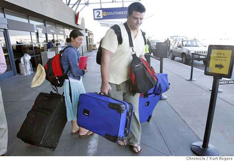 ###Live Caption:Derek Lobedan and Lauren Hanna of San Francisco turn around and head home from the Oakland International Airport in Oakland, Calif., after their ATA flight to Hawaii was canceled on Thursday, April 3, 2008. Photo By Kurt Rogers / San Francisco Chronicle###Caption History:Lauren Hanna and Derek Lobedan of San Francisco turn around and head home after their ATA flight to Hawaii was canceled On Thursday April 3, 2008 in Oakland , Calif  Photo By Kurt Rogers / San Francisco Chronicle###Notes:ATA airlines, a discount airline, filed for bankruptcy and closed today.Lauren Hanna and Derek Lobedan###Special Instructions:MANDATORY CREDIT FOR PHOTOG AND SAN FRANCISCO CHRONICLE/NO SALES-MAGS OUT Photo: Kurt Rogers