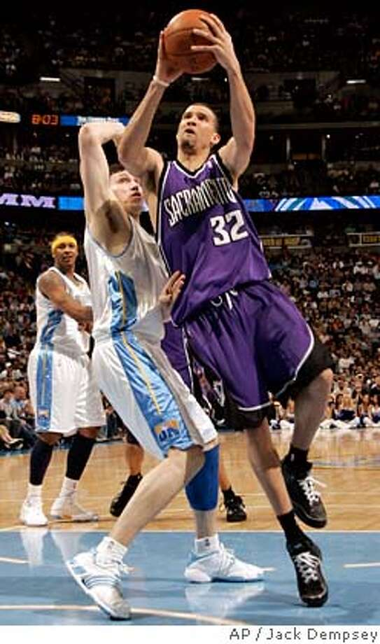 Sacramento Kings forward Francisco Garcia (32) of the Dominican Republic goes up for a shot against Denver Nuggets forward Eduardo Najera (21) from Mexico during the second quarter of an NBA basketball game in Denver, Saturday, April 5, 2008. (AP Photo/Jack Dempsey) Photo: Jack Dempsey