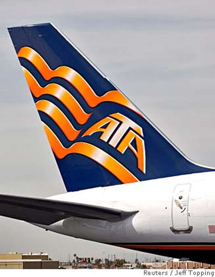 ###Live Caption:The ATA logo is seen on the tail of one of its aircraft at Phoenix Sky Harbor International Airport in Phoenix, Arizona, April 4, 2008. ATA Airlines Inc said on Thursday it filed for Chapter 11 bankruptcy protection and shut down all operations after cancellation of a key military charter agreement. REUTERS/Jeff Topping (UNITED STATES)###Caption History:The ATA logo is seen on the tail of one of its aircraft at Phoenix Sky Harbor International Airport in Phoenix, Arizona, April 4, 2008. ATA Airlines Inc said on Thursday it filed for Chapter 11 bankruptcy protection and shut down all operations after cancellation of a key military charter agreement. REUTERS/Jeff Topping (UNITED STATES)###Notes:The ATA logo is seen on the tail of one of its aircraft at Phoenix Sky Harbor International Airport in Phoenix###Special Instructions: Photo: JEFF TOPPING