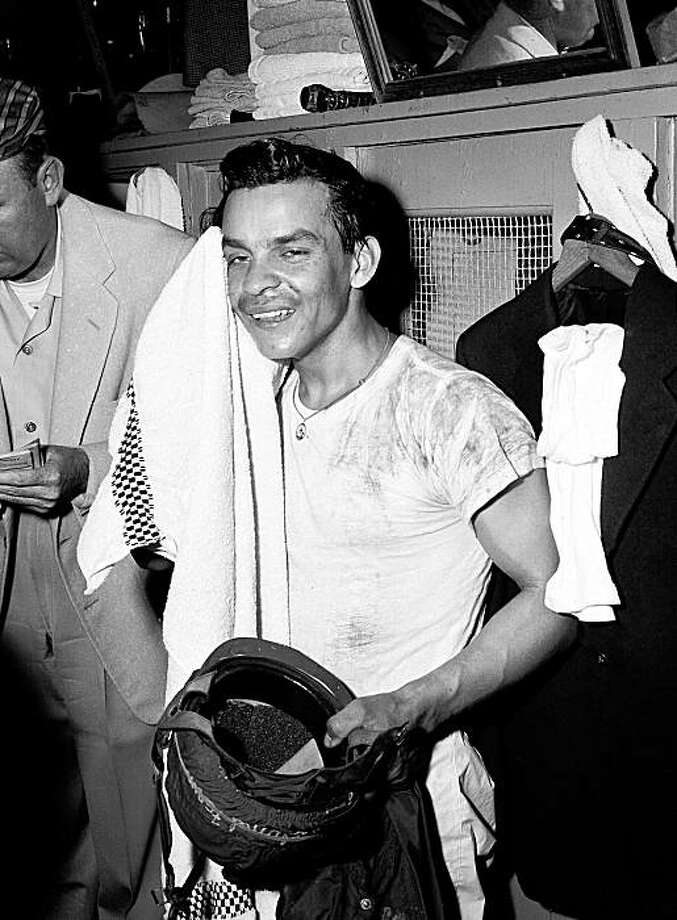 """** CORRECTS KENTUCKY DERBY WINNER TO TIM TAM, NOT KELSO ** FILE - In this May 3, 1958 file photo, jockey Ismael """"Milo"""" Valenzuela is shown in the lockers after riding Tim Tam to win the Kentucky Derby horse race at Churchill Downs in Louisville, Ky.  Hall of Fame jockey Ismael """"Milo"""" Valenzuela, who won the 1958 Kentucky Derby and also rode Horse of the Year Kelso, died on Wednesday, Sept. 2, 2009, after a long illness. He was 74. (AP Photo/File) Photo: Anonymous, AP"""