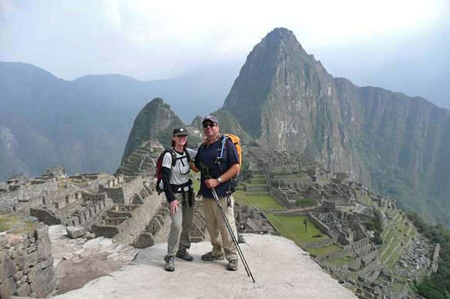 "###Live Caption:Geralyn and Paul Bandur at Machu Picchu in Peru.###Caption History:TRAVEL JUSTBACK -- C_Documents and SettingsGeralyn BandurMy DocumentsMy PicturesPeru 2007Christmas photo AW.jpg  Geralyn and Paul Bandur, San Ramon, CA Email: geralynbandur@comcast.net  Daytime phone number: 925-518-9381 Just back from: Machu Picchu, Peru I went because: To hike the Inca Trail to Machu Picchu. Twenty eight miles over four days and absolutely the best way to get your first glimpse of the ""Lost City"". Don't miss: Spending a few days in Cusco. You need to acclimatize to the 11,300 ft altitude anyway and the city is beautiful, historical and has great restaurants Don't bother: Spending extra time in Lima. Cusco is much more interesting. Coolest souvenir: All things Alpaca - The sweaters are beautiful and the prices are really quite exceptional. Worth a splurge: A room at The Hotel Monasterio in Cusco after four days of hiking. I wish I'd packed: Warmer sleeping bags. The nights were cooler than we had expected for September. Other comments: This trip surpassed our expectations. The beauty of the Andes is not to be missed! Details of attached photo (if sent): Geralyn and Paul at our arrival at Machu Picchu 1/23/08 in , .###Notes:justback just back###Special Instructions: Photo: None"
