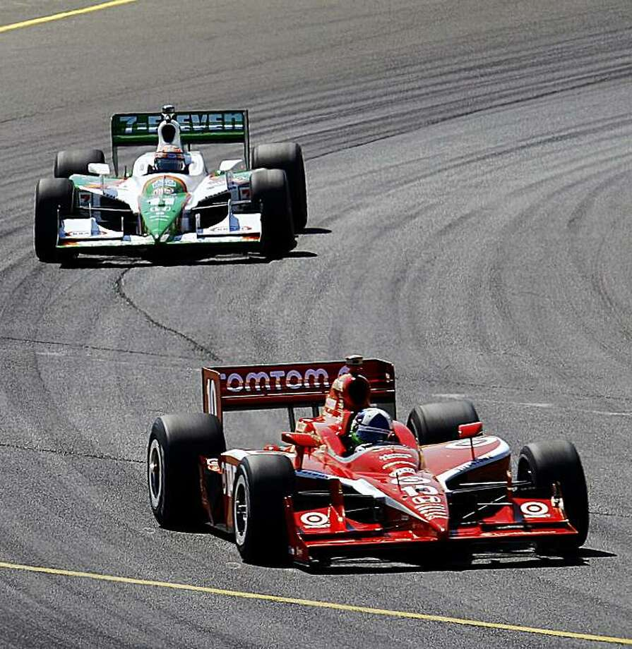 IRL driver Dario Franchitti, foreground, of Scotland, leads Tony Kanaan, of Brazil, during a practice lap in preparation for the Indy Grand Prix of Sonoma auto race, Saturday, Aug. 22, 2009, at Infineon Raceway in Sonoma, Calif. Franchitti had the fastest lap to qualify for the pole position in Sunday's race. (AP Photo/Ben Margot) Photo: Ben Margot, AP
