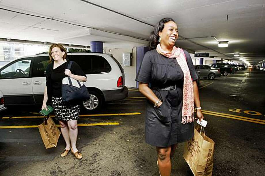 Consultants Jill Casey (left) and Jara Dean-Coffey (right) bought shoes on sale after their business meeting and are getting their cars at the Fifth & Mission/Yerba Buena garage in San Francisco, Calif. on Wednesday, September 2, 2009. Photo: Liz Hafalia, The Chronicle