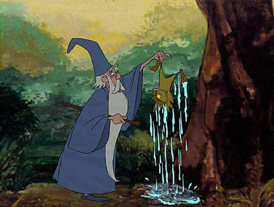 """The Sword in the Stone"": Merlin and Archimedes Photo: Disney 1963"
