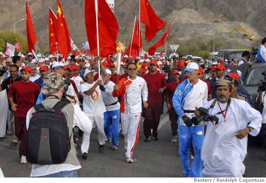 ###Live Caption:Sayyid Shihab, adviser to Oman's Sultan Qaboos Bin Saeed, runs with the Olympic torch at the start of the relay in Muscat April 14, 2008. REUTERS/Randolph Caguintuan (OMAN)###Caption History:Sayyid Shihab, adviser to Oman's Sultan Qaboos Bin Saeed, runs with the Olympic torch at the start of the relay in Muscat April 14, 2008. REUTERS/Randolph Caguintuan (OMAN)###Notes:Sayyid Shihab, adviser to Oman's Sultan Qaboos Bin Saeed, runs with Olympic torch at start of relay in Muscat###Special Instructions:0 Photo: STR