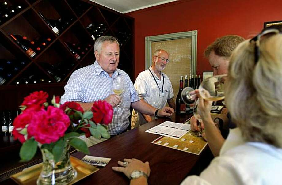 Roger Roessler (left) and his brother Richard (center) pours wine for guests Roessler Cellars tasting room in Sonoma, Calif., on Saturday, July 18, 2009. Photo: Paul Chinn, The Chronicle