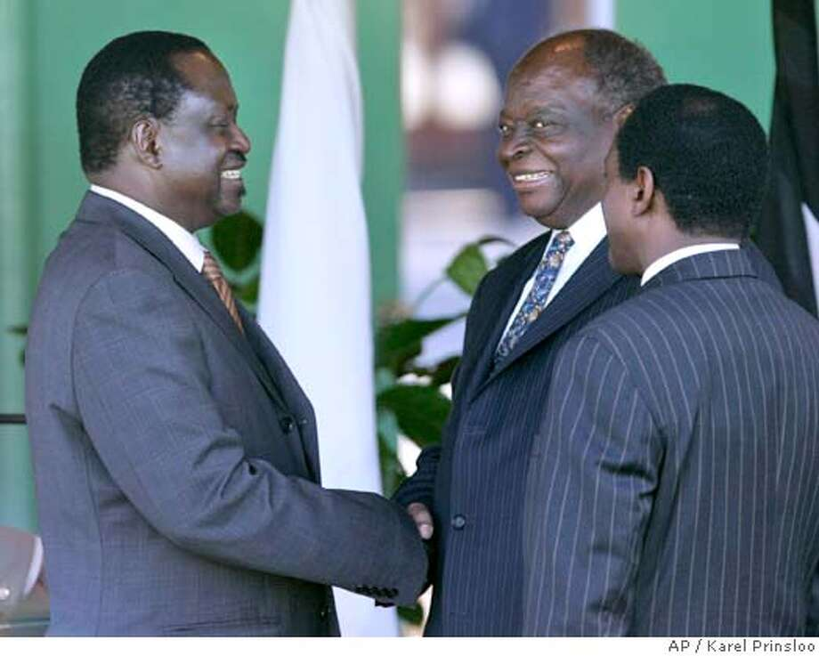 Opposition leader Raila Odinga, left, shake hands with Kenyan President Mwai Kibaki, center, and Kenyan Vice President Kalonzo Musyoka look on, right, after he announced the cabinet and Odinga as the Prime Minister, Sunday, April 13, 2008 at State House in Nairobi, Kenya. President Mwai Kibaki on Sunday named rival Raila Odinga as prime minister, implementing a power-sharing deal after protracted negotiations over the deal they signed over a month ago. (AP Photo/Karel Prinsloo) Photo: KAREL PRINSLOO