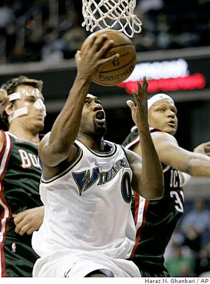 Wizards guard Gilbert Arenas drives to the basket past Milwaukee's Andrew Bogut, left, and Charlie Villanueva during the fourth quarter on Wednesday, April 2, 2008, in Washington. Photo: Haraz N. Ghanbari, AP