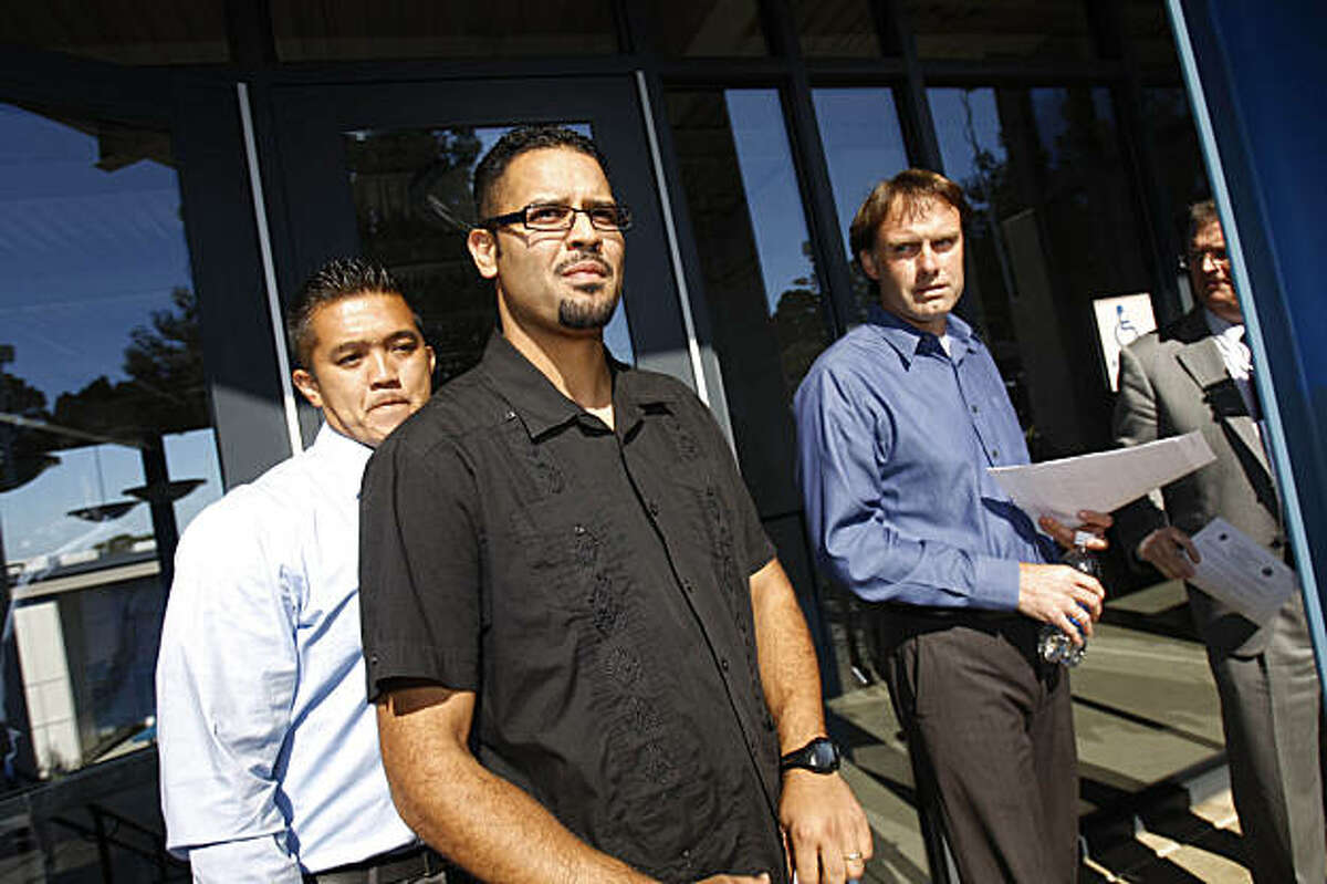 Counselor Ed Canda ( l to r), Principal Jeff Gilbert and teacher Kennet Santana arrive at a press conference to address the media at Hillsdale High School in San Mateo, Calif. on Tuesday, August 25, 2009.