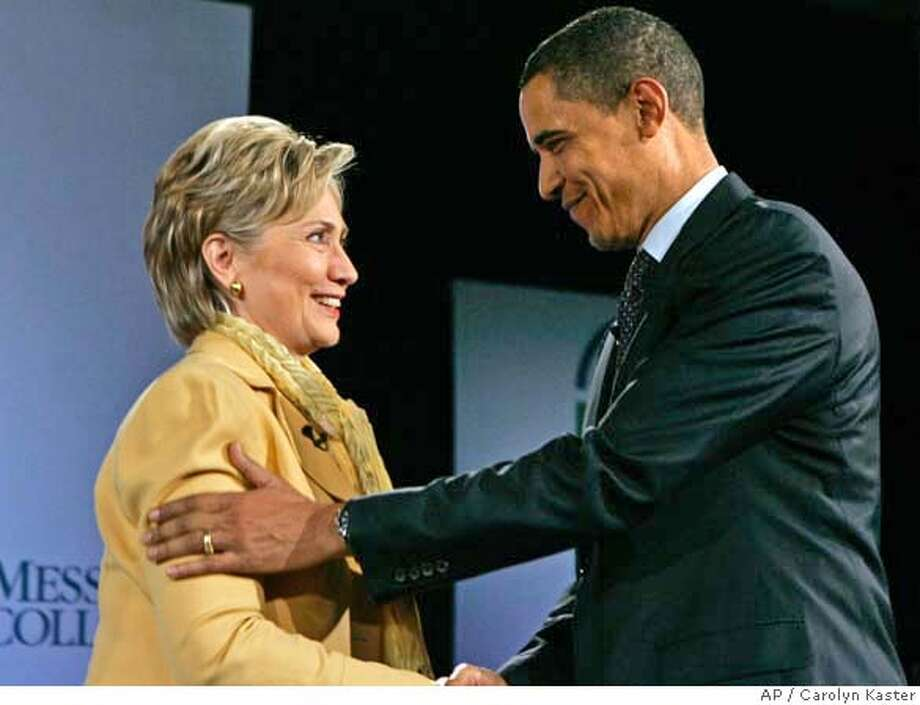 ###Live Caption:Democratic presidential hopeful, Sen. Hillary Rodham Clinton, D-N.Y., shakes hands with Democratic presidential hopeful, Sen. Barack Obama, D-Ill., as they participate in a Compassion Forum at Messiah College, in Grantham, Pa., Sunday, April 13, 2008. (AP Photo/Carolyn Kaster)###Caption History:Democratic presidential hopeful, Sen. Hillary Rodham Clinton, D-N.Y., shakes hands with Democratic presidential hopeful, Sen. Barack Obama, D-Ill., as they participate in a Compassion Forum at Messiah College, in Grantham, Pa., Sunday, April 13, 2008. (AP Photo/Carolyn Kaster)###Notes:Hillary Rodham Clinton, Barack Obama###Special Instructions: Photo: Carolyn Kaster