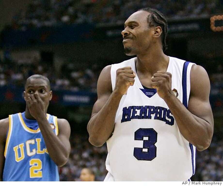 Memphis' Joey Dorsey (3) reacts as UCLA's Darren Collison (2) looks on during a semifinals game at the college basketball Final Four Saturday, April 5, 2008, in San Antonio. (AP Photo/Mark Humphrey) Photo: Mark Humphrey