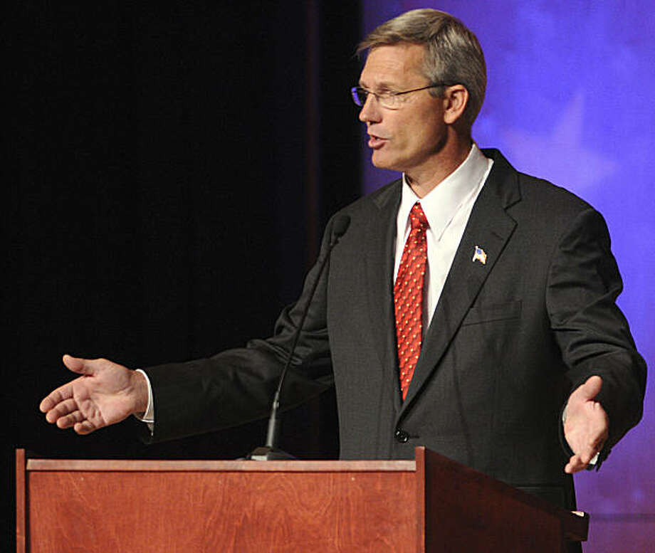 "FILE - This Tuesday night Oct. 21, 2008 picture shows Rex Rammell during a debate for the U.S. Senante seat vacated by Sen. Larry Craig at the Brandt Center on the the Northwest Nazarene University campus in Nampa, Idaho. The Idaho Republican gubernatorial hopeful insists he was only joking when he said he'd buy a license to hunt President Barack Obama. Rammell, a long-shot candidate slated to run against incumbent C.L. ""Butch"" Otter in the May 2010 Republican primary, made the comment at a rally Tuesday, Aug. 25, 2009 in Twin Falls, Idaho where talk turned to the state's planned wolf hunt, for which hunters must purchase an $11.50 wolf tag. (AP Photo/The Idaho Press-Tribune, Mike Vogt) ** MANDATORY CREDIT: MIKE VOGT/IDAHO PRESS-TRIBUNE ** Photo: Mike Vogt, Idaho Press-Tribune"