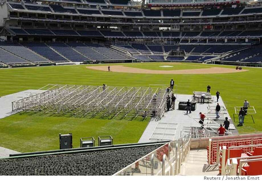 ###Live Caption:A crew begins to assemble a stage in the outfield for an outdoor mass by Pope Benedict XVI, at the Nationals Park in Washington, April 14, 2008. The Pope will be visiting Washington, on his first visit to the United States as Pope, this week and meeting with U.S. President George W. Bush at the White House. REUTERS/Jonathan Ernst (UNITED STATES)###Caption History:A crew begins to assemble a stage in the outfield for an outdoor mass by Pope Benedict XVI, at the Nationals Park in Washington, April 14, 2008. The Pope will be visiting Washington, on his first visit to the United States as Pope, this week and meeting with U.S. President George W. Bush at the White House. REUTERS/Jonathan Ernst (UNITED STATES)###Notes:A crew begins to assemble a stage in the outfield for an outdoor mass by Pope Benedict XVI, at the Nationals Park in Washington###Special Instructions:0 Photo: JONATHAN ERNST