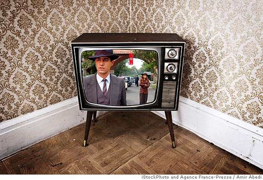 television in a wallpapered room with static on the screen Photo: Shaun Lowe/iStockPhoto.com