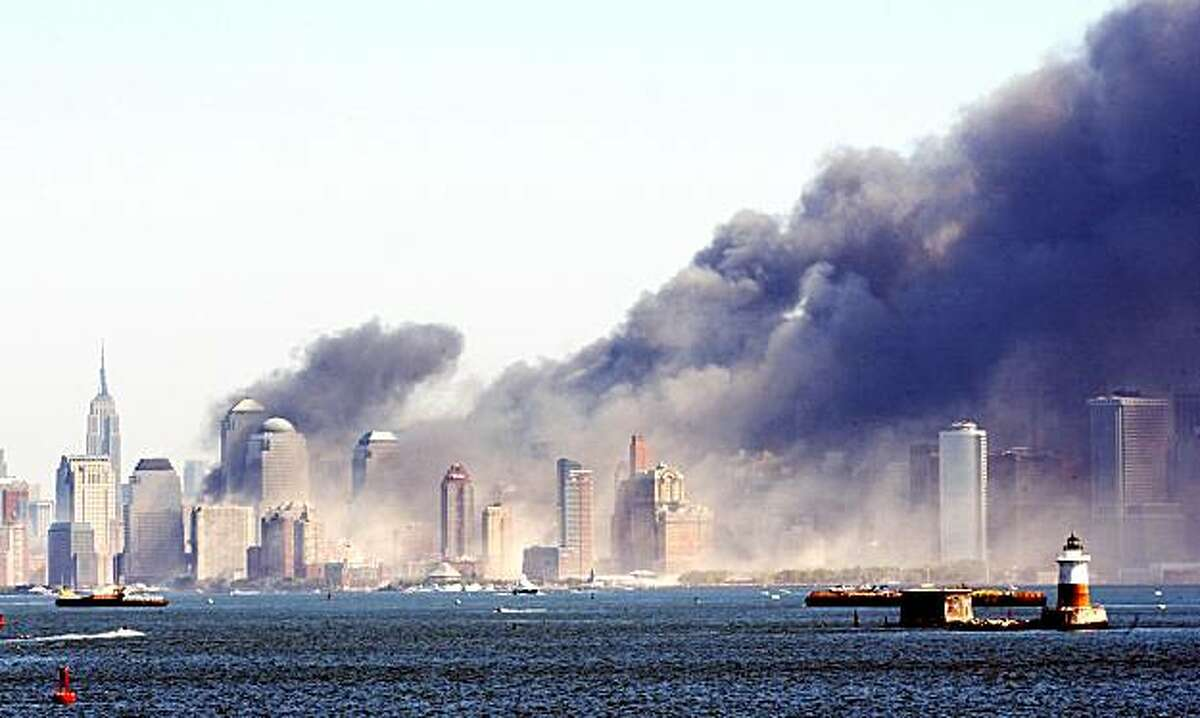 Smoke billows from lower Manhattan, Tuesday, Sept. 11, 2001, in New York, after two planes crashed into the World Trade Center, collapsing the twin 110-story towers. Explosions also rocked the Pentagon and the State Department. (AP Photo/Chad Rachman)