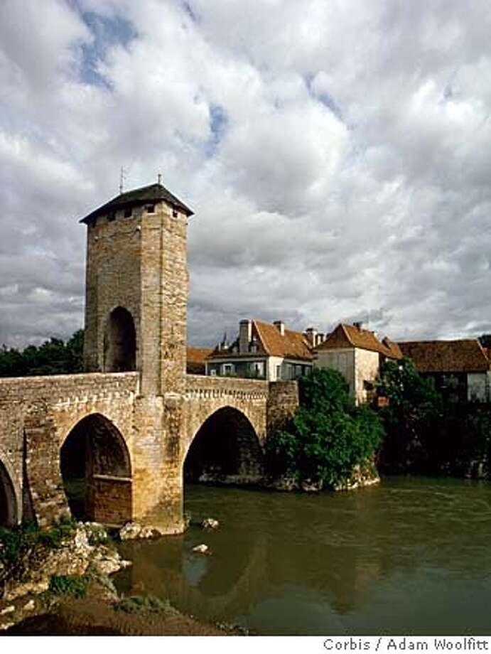###Live Caption:ca. 1970-1995, Orthez, Gascony, France --- The Pilgrim Bridge crosses the river in Orthez, Gascony, France. The bridge is so named as it was one of the major points in the journey of the pilgrims from Paris to Santiago. --- Image by © Adam Woolfitt/CORBIS###Caption History:ca. 1970-1995, Orthez, Gascony, France --- The Pilgrim Bridge crosses the river in Orthez, Gascony, France. The bridge is so named as it was one of the major points in the journey of the pilgrims from Paris to Santiago. --- Image by � Adam Woolfitt/CORBIS###Notes:Pilgrim Bridge###Special Instructions:For latest restrictions check www.corbis.com Photo: Adam Woolfitt