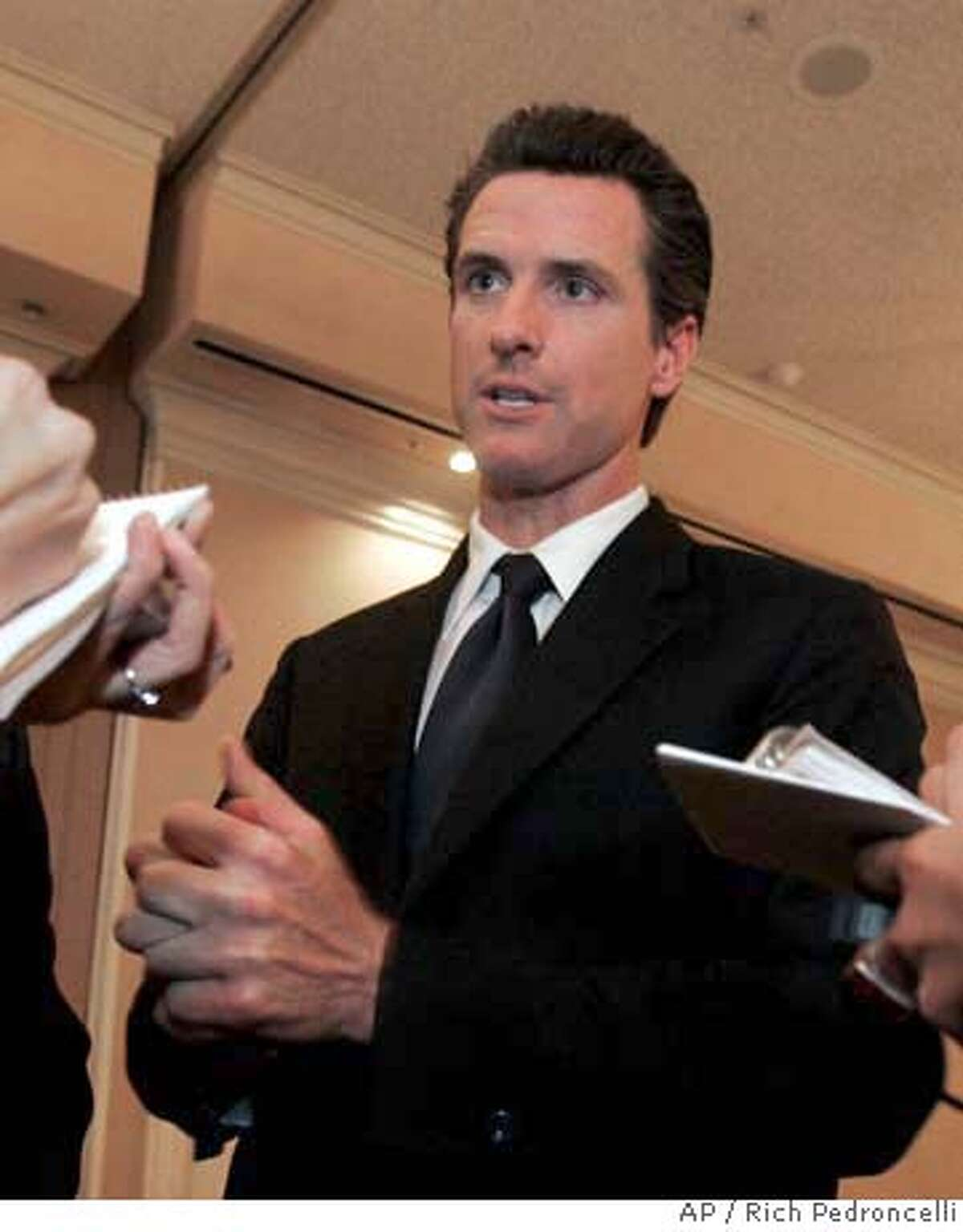 ###Live Caption:San Francisco Mayor Gavin Newsom talks to reporters after his appearance before the Sacramento Press Club in Sacramento, Calif., Tuesday, March 25, 2008. Newsom is criticizing deep cuts to California's Medi-Cal program and says he is considering a lawsuit to reinstate some of the funding. (AP Photo/Rich Pedroncelli)###Caption History:San Francisco Mayor Gavin Newsom talks to reporters after his appearance before the Sacramento Press Club in Sacramento, Calif., Tuesday, March 25, 2008. Newsom is criticizing deep cuts to California's Medi-Cal program and says he is considering a lawsuit to reinstate some of the funding. (AP Photo/Rich Pedroncelli) Ran on: 03-26-2008 San Francisco Mayor Gavin Newsom says the 10 percent reduction in Medi-Cal payments would impose an unfair burden on the citys taxpayers. Ran on: 03-26-2008 San Francisco Mayor Gavin Newsom says the 10 percent reduction in Medi-Cal payments would impose an unfair burden on the citys taxpayers. Ran on: 04-01-2008 Mayor Gavin Newsom has divested himself of local business holdings but still has plenty of financial connections in Napa County and the Lake Tahoe area. Ran on: 04-01-2008###Notes:Gavin Newsom###Special Instructions: