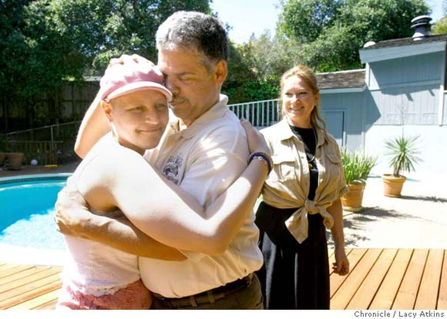 Evanthia Pappas hugs Donald Rubbo after she works with him and his wife Cheryl-Lynn during a healing section, Thursday April 10, 2008, in San Rafael, Calif. Pappas is in the late-stages a rare type of breast cancer. Lacy Atkins / San Francisco Chronicle Photo: Lacy Atkins