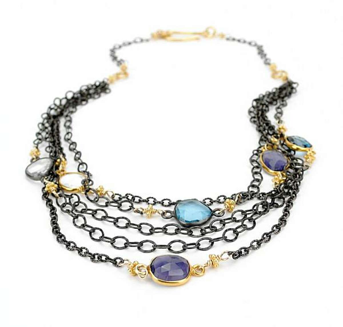 Petaluma jewelry designer Robindira Unsworth's gemstone bib necklace ($450) combines London blue topaz, quartz, iolite, 22K gold vermeil and oxidized sterling silver. It's sold at Margaret O'Leary in San Francisco.