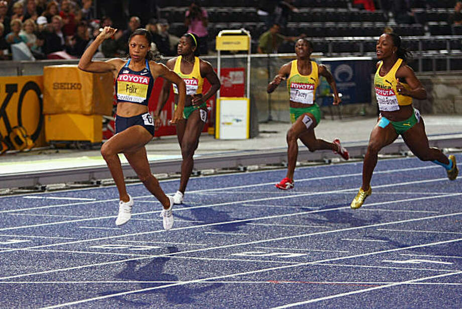 BERLIN - AUGUST 21: Allyson Felix of United States crosses the line to win the gold medal in the women's 200 Metres Final  during day seven of the 12th IAAF World Athletics Championships at the Olympic Stadium on August 21, 2009 in Berlin, Germany.  (Photo by Martin Rose/Bongarts/Getty Images) Photo: Martin Rose, Bongarts/Getty Images