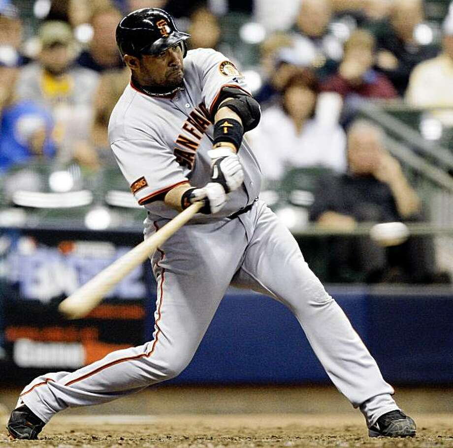 San Francisco Giants' Bengie Molina hits a solo home run during the eighth inning of a baseball game against the Milwaukee Brewers, Friday, Sept. 4, 2009, in Milwaukee. (AP Photo/Morry Gash) Photo: Morry Gash, AP