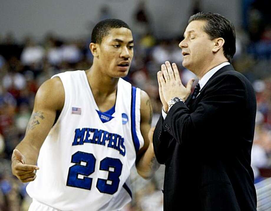 FILE -- This is a March 23, 2008, file photo showing Memphis coach John Calipari talking to Memphis guard Derrick Rose (23) during a time out in the first half of an NCAA basketball game against Mississippi State, in North Little Rock, Ark. Memphis will be forced to vacate the record 38 victories from its Final Four season of 2007-08, according to a report by the Memphis Commercial Appeal. (AP Photo/Sue Ogrocki, File) Photo: Sue Ogrocki, AP