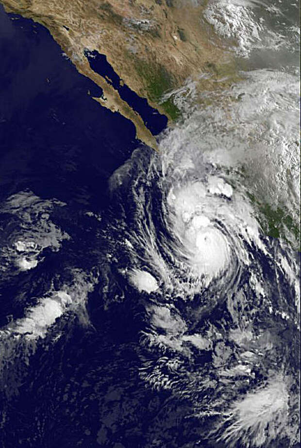 This image provided by NOAA taken at Monday, Aug. 31, 2009 at 8 a.m. EDT shows Hurricane Jimena located near about 370 miles south-southeast of Cabo San Lucas Mexico. Jimena will be approaching the southern portion of the Baja California peninsula on Tuesday. Maximum sustained winds are near 145 mph with higher gusts. Hurricane force winds extend outward up to 30 miles. (AP Photo/NOAA) Photo: NOAA, AP