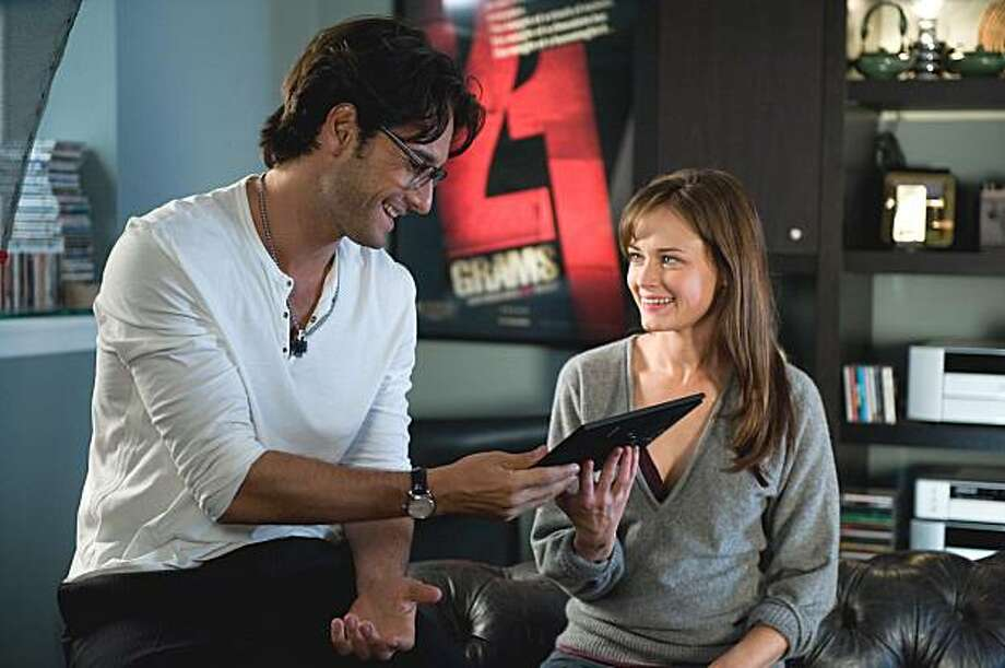 """In this film publicity image released by Fox Searchlight, Rodrigo Santoro, left, and Alexis Bledel are shown in a scene from """"Post Grad."""" Photo: Suzanne Tenner, AP"""