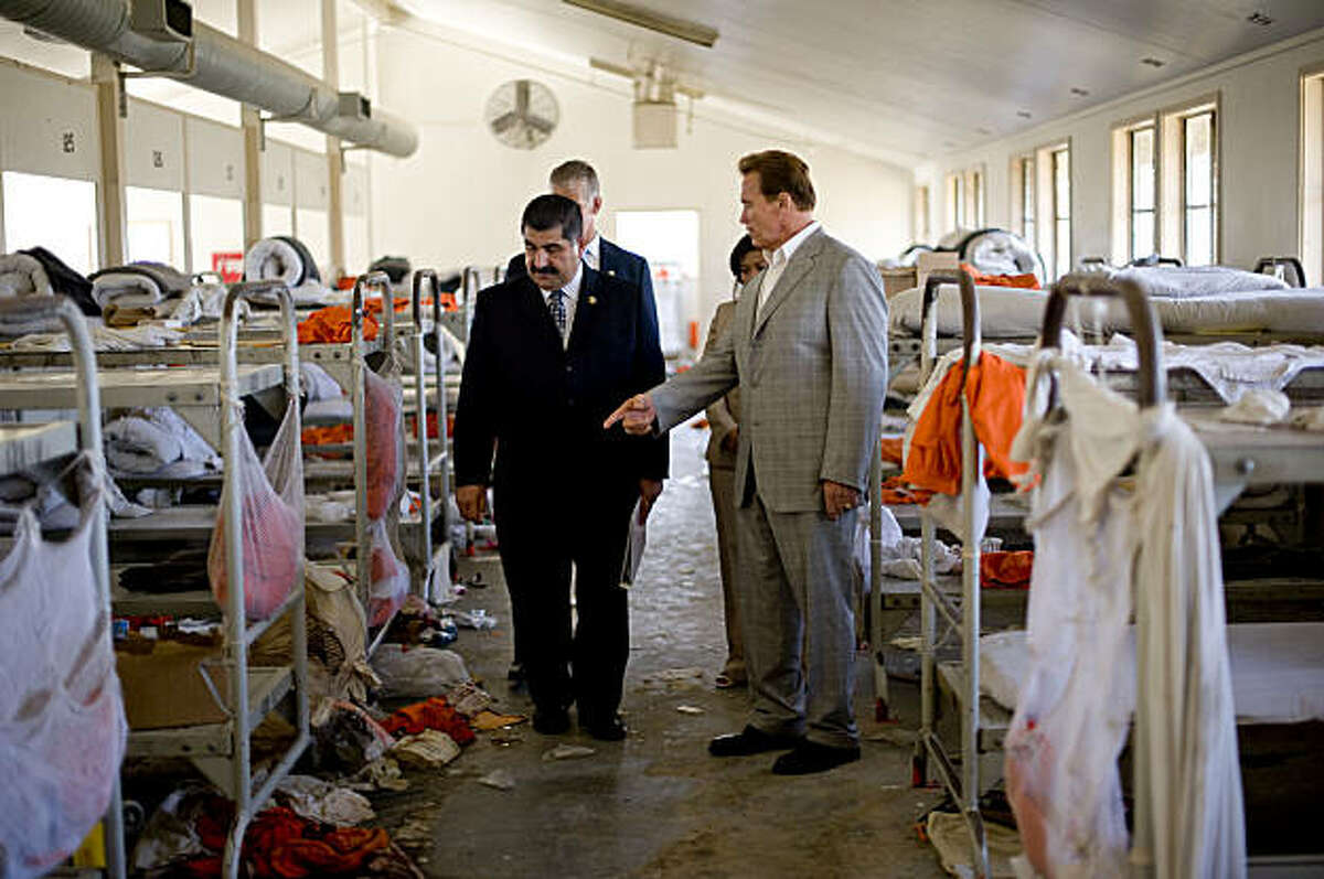 CHINO, CA - AUGUST 19: California Governor Arnold Schwarzenegger (R) tours the California Institution for Men prison with Warden Aref Fakhoury (L) on August 19, 2009 in Chino, California. After touring the prison where a riot took place on August 8th, Schwarzenegger said that the prison system is collapsing and needs to be reformed. (Photo by Michal Czerwonka/Getty Images)