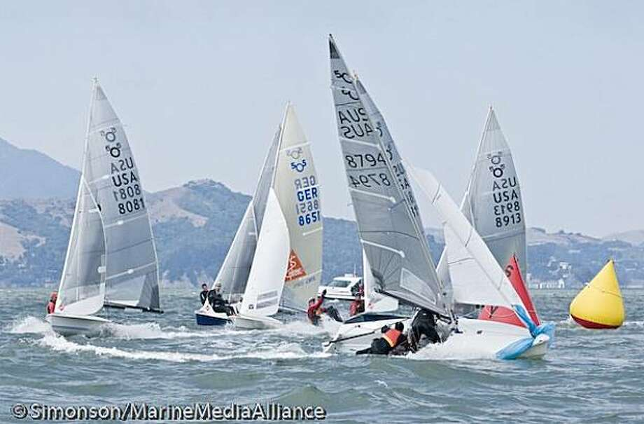International 5O5 boats pile up around a mark in championship racing off Berkeley Photo: Simonson/Marine Media Alliance