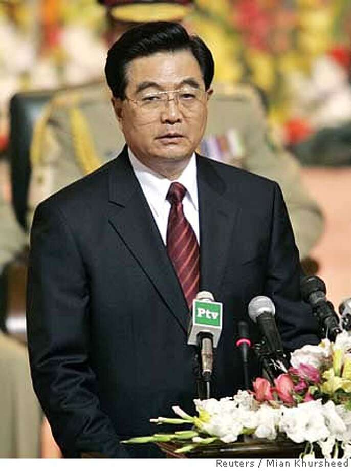 China's President Hu Jintao speaks during a ceremony in Islamabad November 24, 2006. China signed a free trade pact with old ally Pakistan on Friday as Hu promised to bolster ties to a new level. REUTERS/Mian Khursheed (PAKISTAN) 0 Photo: MIAN KHURSHEED