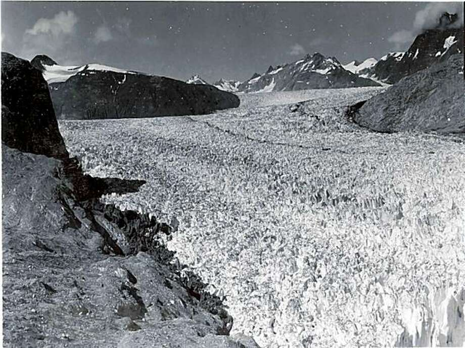 A late 19th century postcard of the Muir Glacier in Alaska's Glacier Bay National Park, and a 2005 photograph taken from the same spot, shows how swiftly the glacier has retreated and left open water in little more than a century of climate change. Photo: Bruce F. Molnia, USGS