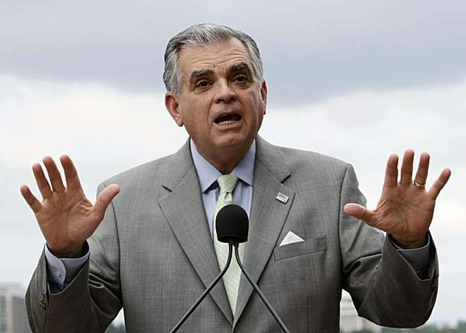 Transportation Secretary Ray LaHood gestures during a news conference in Washington, Wednesday, Aug. 19, 2009, where he assured frustrated car dealers that they will be reimbursed for the popular Cash for Clunkers program, for buyers trading in older vehicles for new, more fuel-efficient models. (AP Photo/J. Scott Applewhite) Photo: J. Scott Applewhite, AP