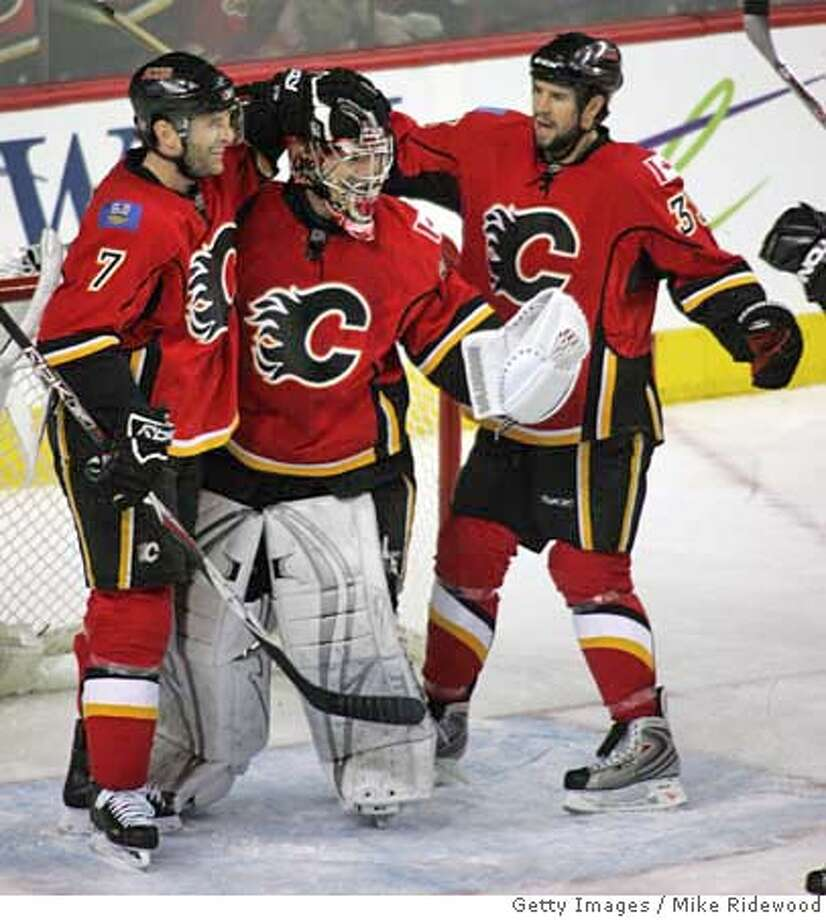 ###Live Caption:CALGARY, CANADA - APRIL 13: Goaltender Curtis Joseph #31 of the Calgary Flames is congratulated by teammates Stephane Yelle #7 and Adrian Aucoin #33 after the Flames defeated the San Jose Sharks 4-3 in Game 3 of the 2008 NHL Western Conference Quarterfinals at Pengrowth Saddledome April 13, 2008 in Calgary, Alberta, Canada. (Photo by Mike Ridewood/Getty Images)###Caption History:CALGARY, CANADA - APRIL 13: Goaltender Curtis Joseph #31 of the Calgary Flames is congratulated by teammates Stephane Yelle #7 and Adrian Aucoin #33 after the Flames defeated the San Jose Sharks 4-3 in Game 3 of the 2008 NHL Western Conference Quarterfinals at Pengrowth Saddledome April 13, 2008 in Calgary, Alberta, Canada. (Photo by Mike Ridewood/Getty Images)###Notes:San Jose Sharks v Calgary Flames - Game Three###Special Instructions: Photo: Mike Ridewood