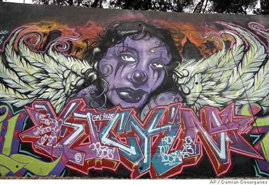 ###Live Caption:An elaborately decorated mural, covered with another graffiti artists addition is seen on the wall along the Los Angeles River on Wednesday, Jan. 16, 2008. It was a graffiti artist's dream come true, 10,000 square feet of concrete just minutes from downtown with a blessing from city officials and a permit to paint. But when some politicians caught sight of the result, they complained that some of the images were inappropriate and the murals encouraged the proliferation of gang-related graffiti. (AP Photo/Damian Dovarganes)###Caption History:An elaborately decorated mural, covered with another graffiti artists addition is seen on the wall along the Los Angeles River on Wednesday, Jan. 16, 2008. It was a graffiti artist's dream come true, 10,000 square feet of concrete just minutes from downtown with a blessing from city officials and a permit to paint. But when some politicians caught sight of the result, they complained that some of the images were inappropriate and the murals encouraged the proliferation of gang-related graffiti. (AP Photo/Damian Dovarganes)###Notes:###Special Instructions:A WED. 16, 2008 PHOTO Photo: Damian Dovarganes