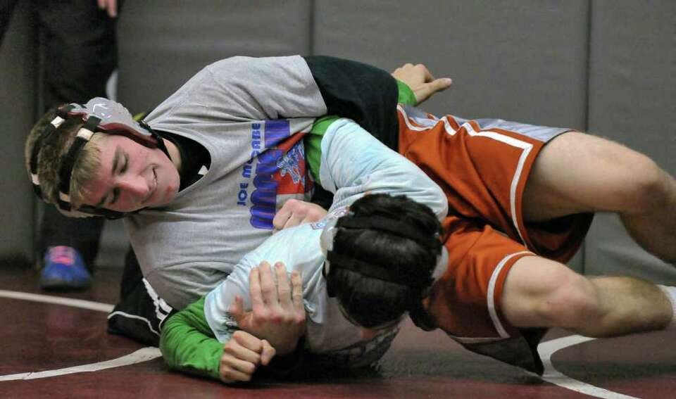 Scotia-Glenville wrestler Josh Culora, left,  scrimmages with Burnt Hills wrestler Nolan Hale at Bur