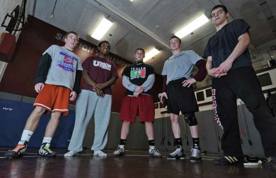 Scotia-Glenville wrestlers, from left to right, Josh Culora, Joe Graham,  Jon Dipace, Nick Leffler and Kyle Merritt take a break during a scrimmage at Burnt Hills-Ballston Lake High School on Tuesday Feb. 7, 2012 in Burnt Hills, NY. (Philip Kamrass / Times Union ) Photo: Philip Kamrass / 00016351A