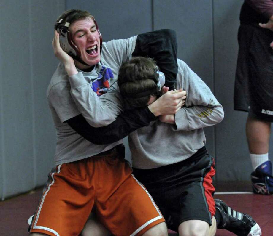 Scotia-Glenville wrestler Josh Culora , left, scrimmages with Burnt Hills wrestler Joey Butler at Burnt Hills-Ballston Lake High School on Tuesday Feb. 7, 2012 in Burnt Hills, NY. (Philip Kamrass / Times Union ) Photo: Philip Kamrass / 00016351A