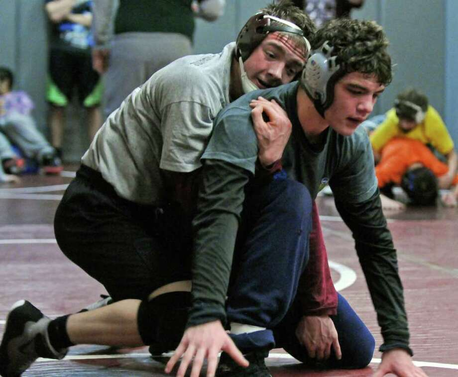 Scotia-Glenville wrestler Nick Leffler , left, scrimmages with Burnt Hills wrestler Jacob Ashcraft at Burnt Hills-Ballston Lake High School on Tuesday Feb. 7, 2012 in Burnt Hills, NY. (Philip Kamrass / Times Union ) Photo: Philip Kamrass / 00016351A