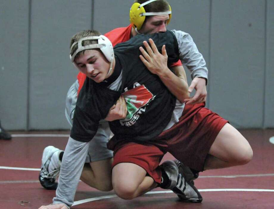 Scotia-Glenville wrestler Jon Dipace , left, scrimmages with Galway wrestler Brandan Aschmutat at Burnt Hills-Ballston Lake High School on Tuesday Feb. 7, 2012 in Burnt Hills, NY. (Philip Kamrass / Times Union ) Photo: Philip Kamrass / 00016351A