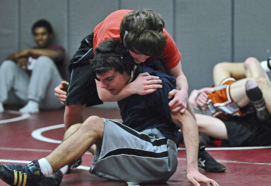Scotia-Glenville wrestler Kyle Merritt, bottom, scrimmages with Galway wrestler Nick Webb-Horvath at Burnt Hills-Ballston Lake High School on Tuesday Feb. 7, 2012 in Burnt Hills, NY. (Philip Kamrass / Times Union ) Photo: Philip Kamrass / 00016351A