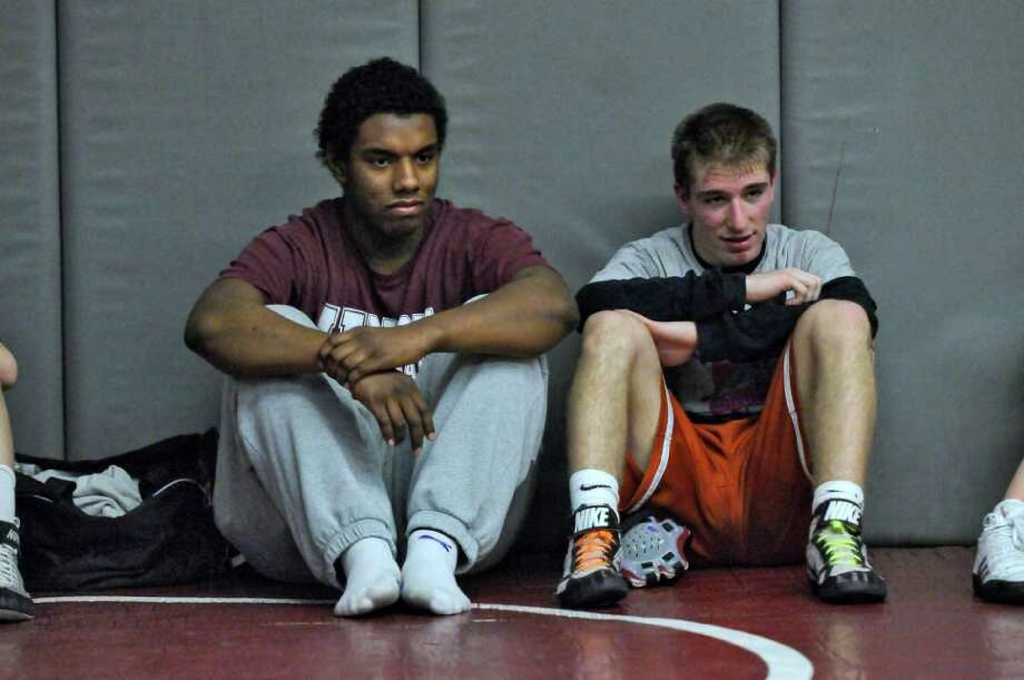 Scotia-Glenville wrestlers Joe Graham, left, and Josh Culora, watch other wrestlers during a scrimmage at Burnt Hills-Ballston Lake High School on Tuesday Feb. 7, 2012 in Burnt Hills, NY. (Philip Kamrass / Times Union ) Photo: Philip Kamrass / 00016351A