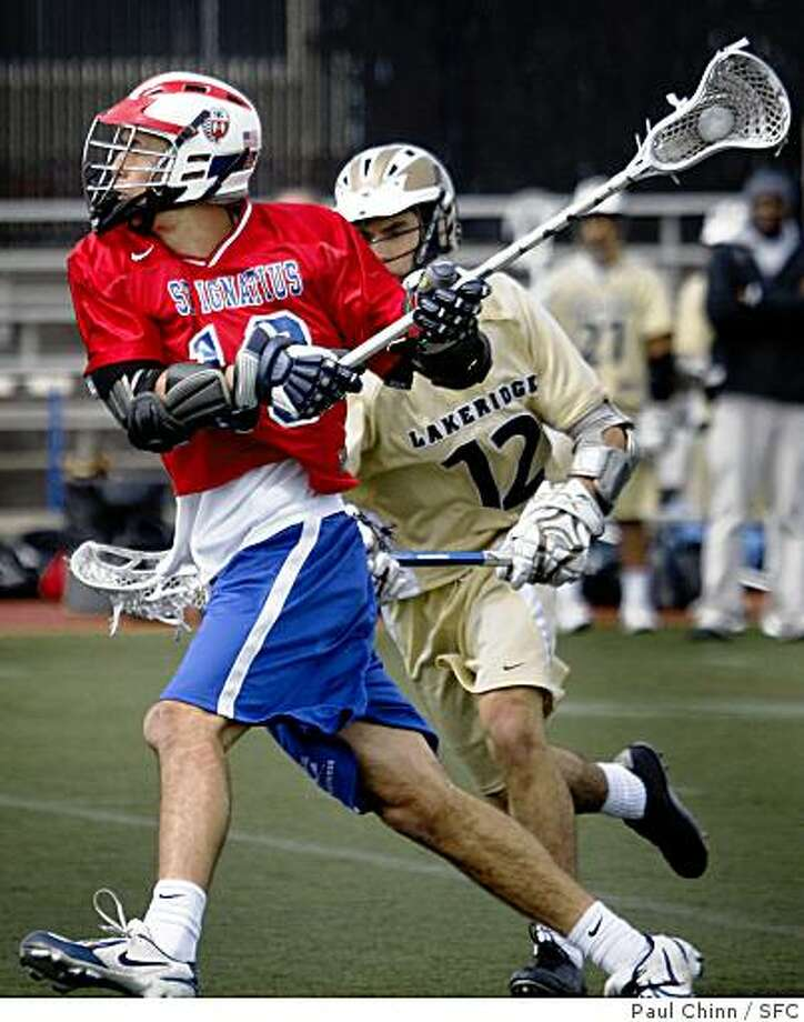 Roy Lang of the Saint Ignatius Wildcats winds up for a shot on goal in front of the Lakeridge Pacers' Jeff Saporito (12) during a lacrosse game in San Francisco, Calif., on Saturday, March 29, 2008.Photo by Paul Chinn / San Francisco Chronicle Photo: Paul Chinn, SFC
