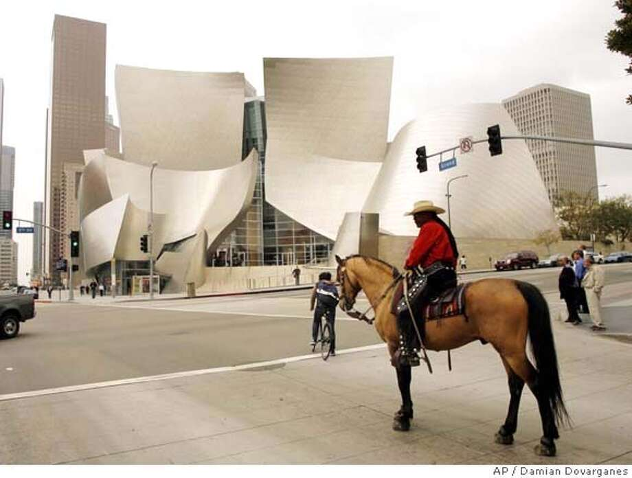"###Live Caption:Educator and horseman Miles Dean, a 52-year-old social studies teacher in Newark, N.J., rides his horse Sankofa, a 9-year-old Arabian-Saddle bred stallion by the Walt Disney Concert Hall downtown Los Angele,s Tuesday, April 1, 2008, on a half-year, 6,000-mile horseback journey from New York to California with a goal of heightening awareness of black cowboys and other African-Americans who helped forge American history. Dean, who calls himself ""a modern African-American pioneer,"" started his journey in Lower Manhattan Saturday, Sept. 22, 2007. (AP Photo/Damian Dovarganes)###Caption History:Educator and horseman Miles Dean, a 52-year-old social studies teacher in Newark, N.J., rides his horse Sankofa, a 9-year-old Arabian-Saddle bred stallion by the Walt Disney Concert Hall downtown Los Angele,s Tuesday, April 1, 2008, on a half-year, 6,000-mile horseback journey from New York to California with a goal of heightening awareness of black cowboys and other African-Americans who helped forge American history. Dean, who calls himself ""a modern African-American pioneer,"" started his journey in Lower Manhattan Saturday, Sept. 22, 2007. (AP Photo/Damian Dovarganes)###Notes:Miles Dean###Special Instructions:STAND ALONE PHOTO Photo: Damian Dovarganes"